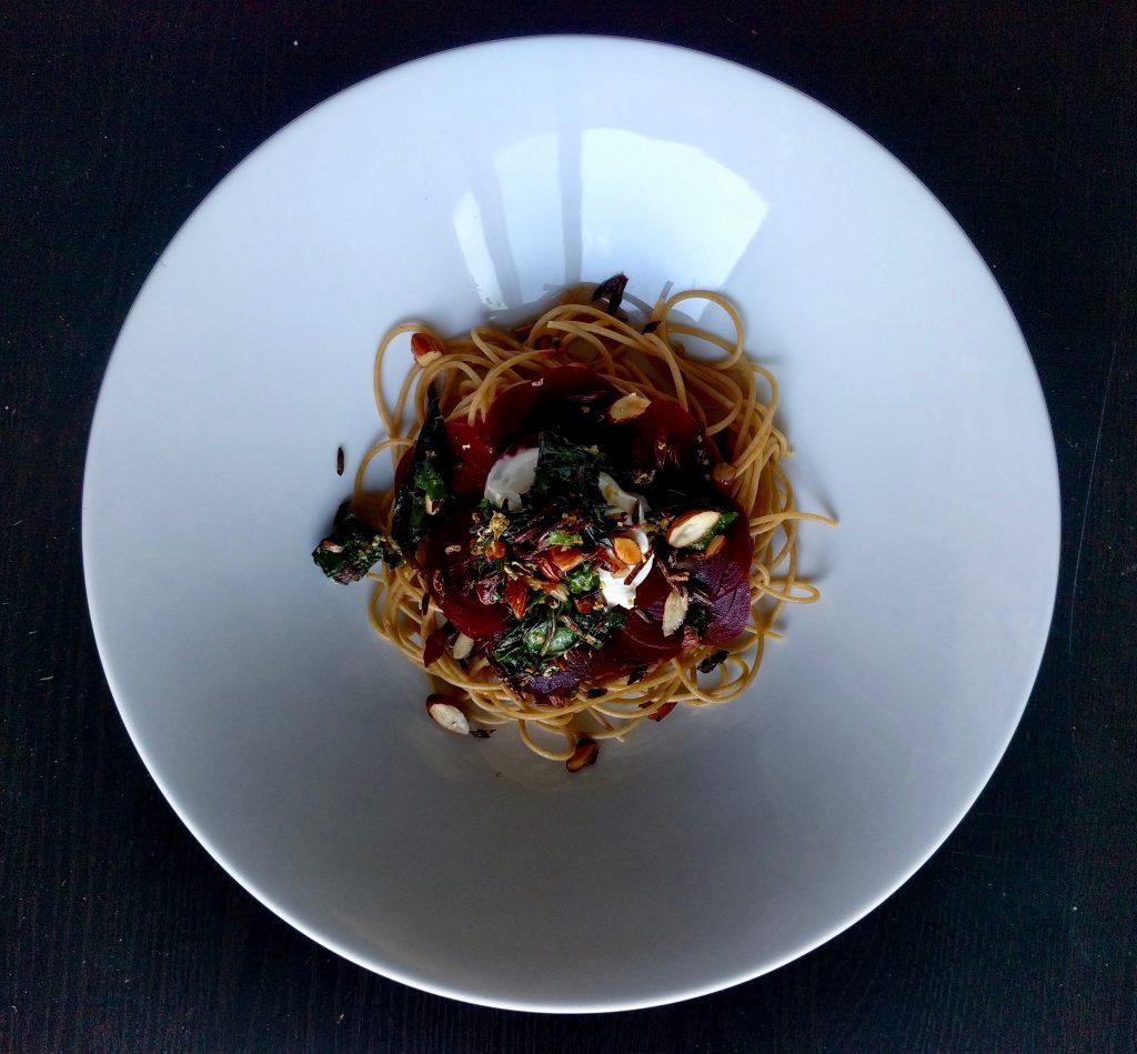 beet pasta black background